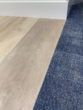 wooden flooring and carpet