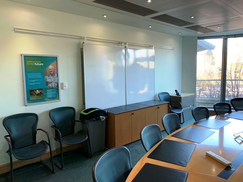 Whiteboard and office furniture in a boardroom