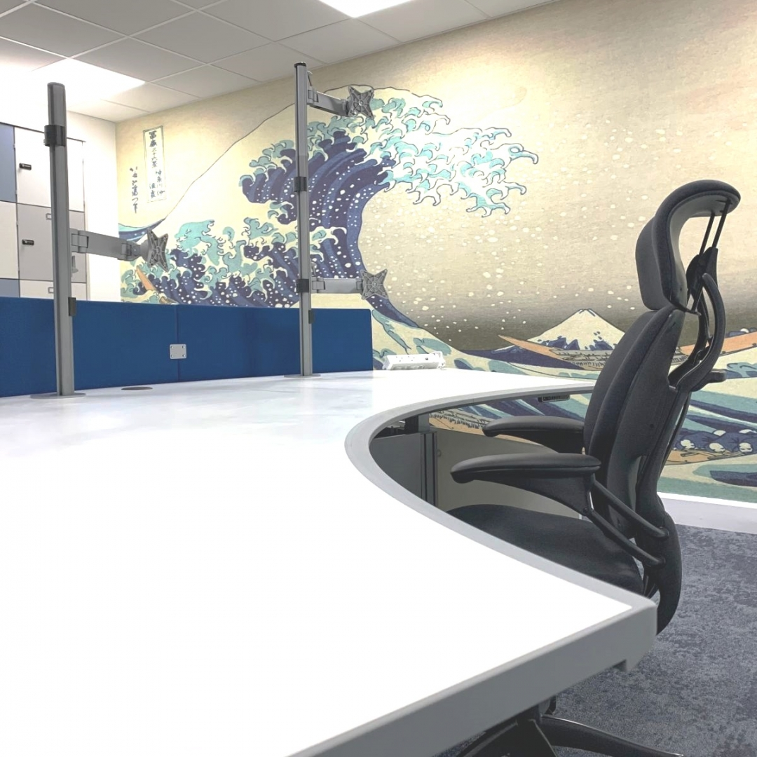 white reception desk and black chair