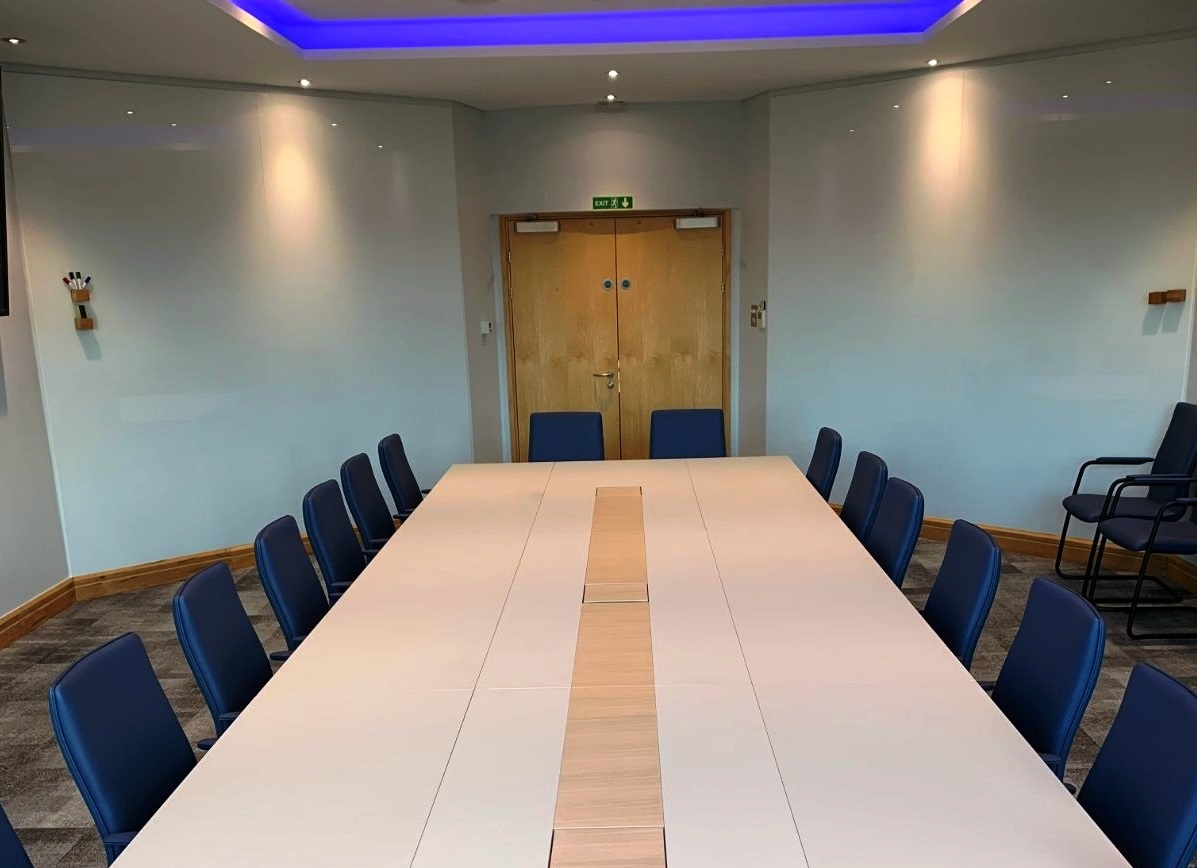 Rectangular boardroom table with writable glass panels