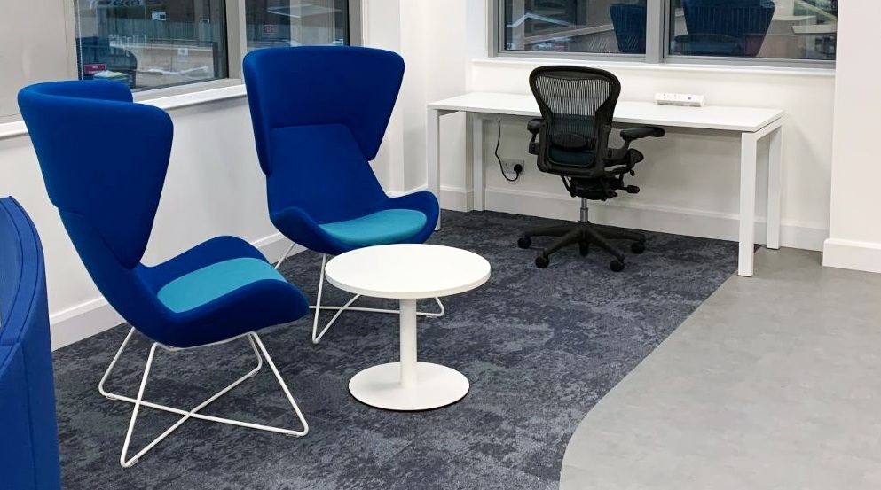Small circular occasional table two blue chairs and a desk and chair