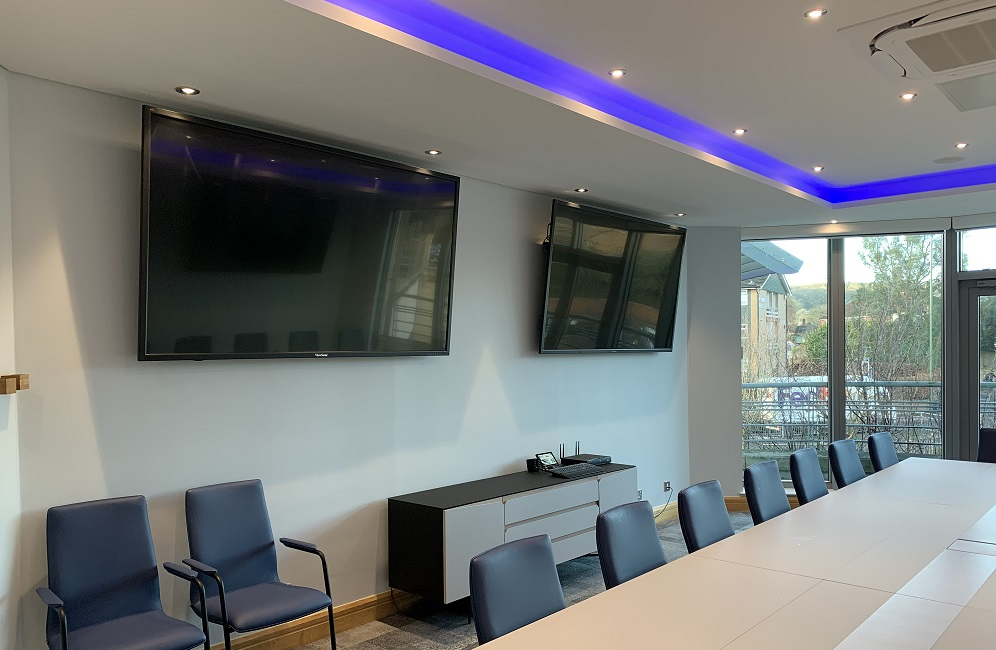 boardroom table chairs storage unit and mounted tv screens