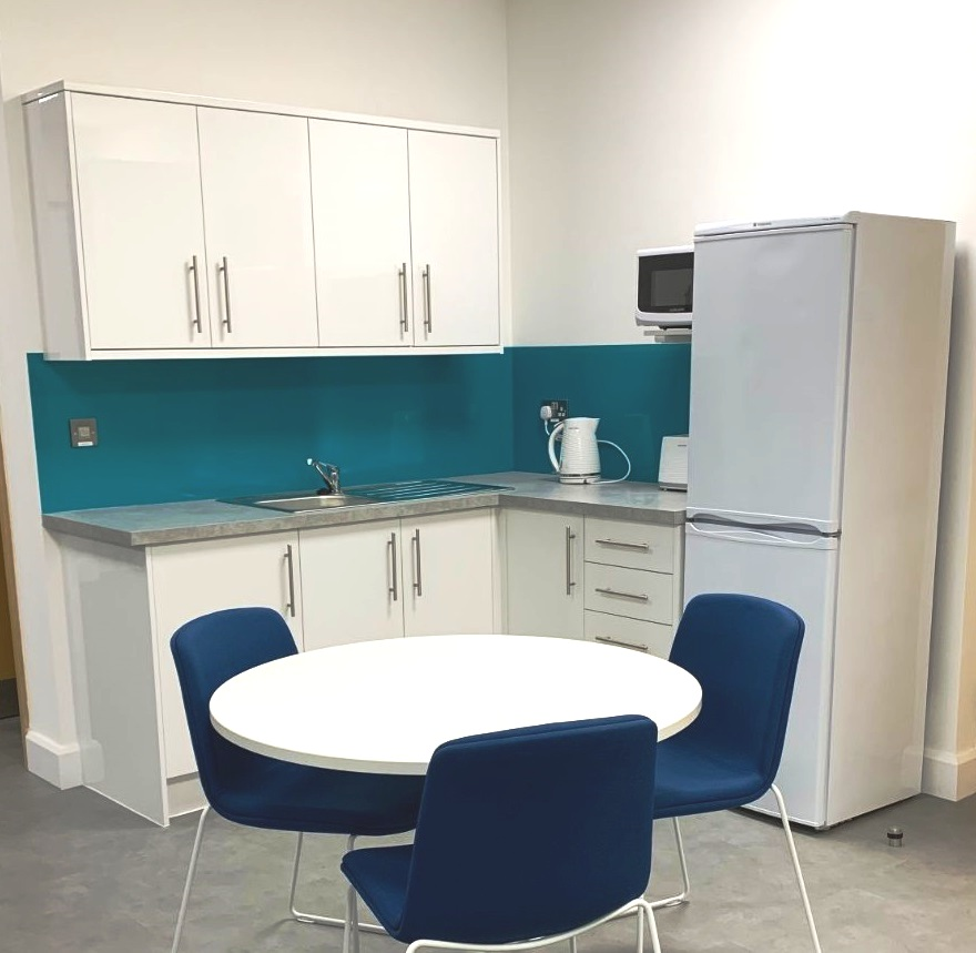 Refurbished staff kitchen and breakout area with a table and chairs